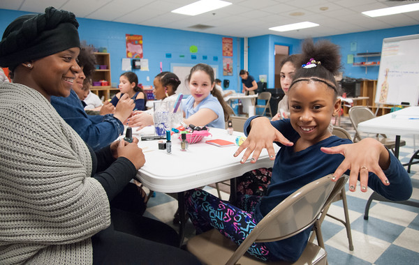 03/29/18 Wesley Bunnell | Staff Zamya Jackson, age 7, smiles as she shows off her freshly painted nails by Cassandra Jones at the Boys and Girls Club on Thursday night. Jones is Program Coordinator for the SMART Girls program at the club where Zamya is a member. The program helps young girls develop life skills in nutrition, physical fitness, self esteem, and anti bullying among others.