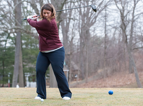 03/29/18 Wesley Bunnell | Staff Mayor Erin Stewart prepares to hit the ceremonial first ball on the first tee on opening day at Stanley Golf Course on Thursday morning.