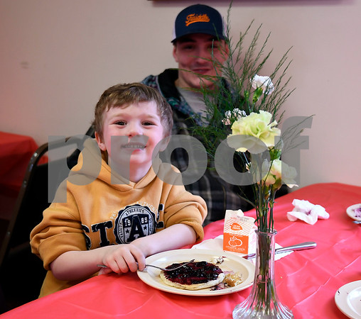 3/10/2018 Mike Orazzi | Staff Noah Grande,4, and his father Louie during the New Britain Youth Museum at Hungerford Park's Annual Maple Sugaring and Pancake Breakfast fundraiser Saturday in Kensington.