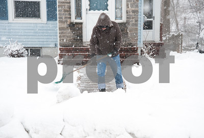 03/13/18  Wesley Bunnell | Staff  Guisseppe Didomenico of Hillcrest Ave shovels his front walkway during the latest snowstorm on Tuesday.