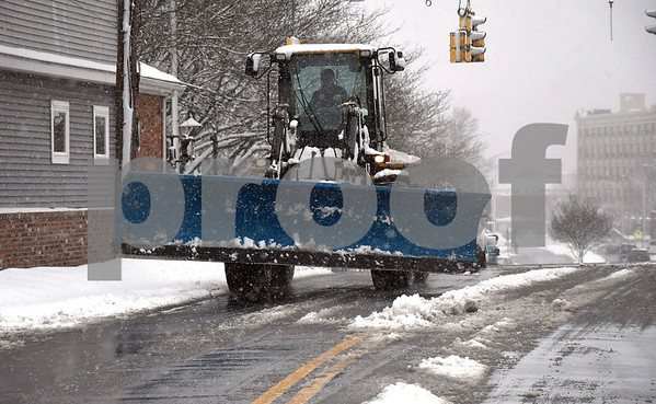 3/13/2018 Mike Orazzi | Staff Snow removal equipment on North Main Street in Bristol during Tuesday's storm.