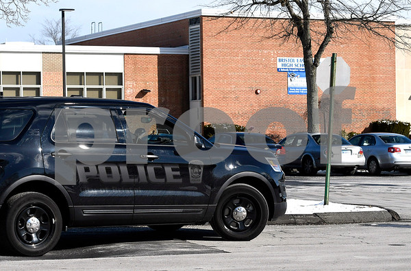 3/14/2018 Mike Orazzi | Staff Bristol police while blocking the entrance to members of the media as Bristol Eastern High School students walked out of school Wednesday to mark the one month anniversary of the Parkland school shooting. Students planned to stay outside for 17 minutes, one minute for each victim, they also want more gun control.