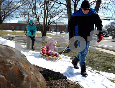 3/15/2018 Mike Orazzi | Staff Samantha Gandarillas,3, enjoys a ride in a patch of snow along Atwater Street in Southington from her grand parents Roger and Linda Taschereau Thursday afternoon.