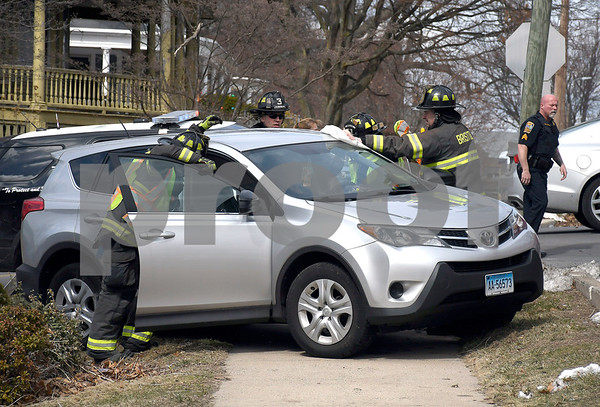 3/16/2018 Mike Orazzi | Staff Rescue personnel remove the driver of a car involved in a two-car crash at the intersection of Summer and Center Streets Friday afternoon. One was transported from the scene.