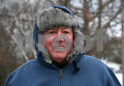 3/16/2018 Mike Orazzi | Staff Al Uris,75, while walking on a windy cold day in Plainville's Norton Park Friday afternoon. Uris said he tries to walk a few miles a day.