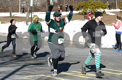 3/17/2018 Mike Orazzi | Staff Jason DeCarolis prepares to cross the finish line during the two mile run and walk at the 16th Annual Shamrock Run and Walk held at the Chippens Hill Middle School Saturday morning.