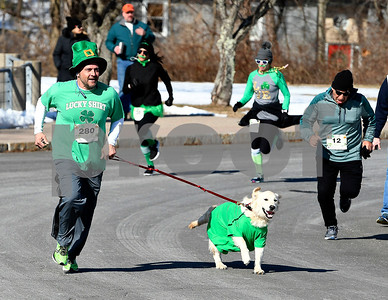 3/17/2018 Mike Orazzi | Staff John Vecchio and Sgt. Peppers during the 16th Annual Shamrock Run and Walk held at the Chippens Hill Middle School Saturday morning.