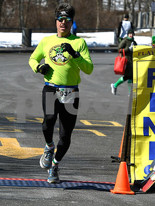 3/17/2018 Mike Orazzi | Staff Andy Barton in the 5 mile run during the 16th Annual Shamrock Run and Walk held at the Chippens Hill Middle School Saturday morning.