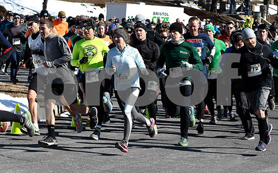 3/17/2018 Mike Orazzi | Staff Participants in the 5 mile run during the 16th Annual Shamrock Run and Walk held at the Chippens Hill Middle School Saturday morning.