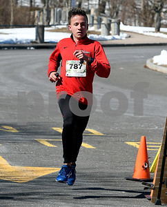 3/17/2018 Mike Orazzi | Staff Spencer Johnson takes first place in the 5 mile run during the 16th Annual Shamrock Run and Walk held at the Chippens Hill Middle School Saturday morning.