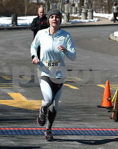 3/17/2018 Mike Orazzi | Staff Maria McPhee was the first female in the 5 mile run during the 16th Annual Shamrock Run and Walk held at the Chippens Hill Middle School Saturday morning.