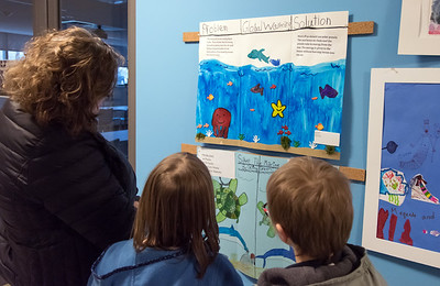 03/20/18  Wesley Bunnell | Staff  Second grade Holmes Elementary students Lindsey , middle, and William Fox stand with their mother during the second annual Inspiration to Innovation Challenge reception at the New Britain Museum of American Art on Tuesday evening. The program, in partnership with the Talcott Mountain Academy, challenged students to combine STEM principles with their artwork which this year was an under the sea theme.