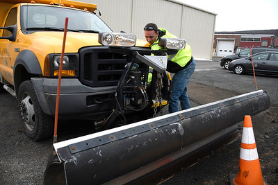 3/21/2018 Mike Orazzi | Staff Dan Covaleski connects a plow at the City of Bristol Department of Public Works on Vincent P. Kelly Road Tuesday.
