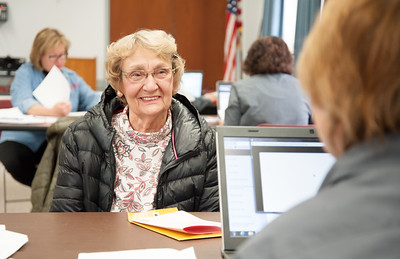 03/20/18  Wesley Bunnell | Staff  Erika Swenson of Berlin smiles as she sits across from AARP Tax-Aide Volunteer Sue Myskowski at the Berlin-Peck Library on Tuesday afternoon. The tax preparation program is funded by the AARP Foundation and the IRS and helps over 25,000 seniors across CT.  Upcoming locations include the Berlin-Peck Library, New Britain Senior Center, Newington Library, Plainville Senior Center, Southington Senior Center and the Bristol Senior Center. Potential volunteers can find more information at www.aarpfoundation.org/taxaidevolunteer .