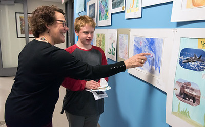 03/20/18  Wesley Bunnell | Staff  New Britain Museum of American Art's Director of Education Cindy Cormier points out details of Jonathan Kelly's artwork during a reception on Tuesday evening. The second annual Inspiration to Innovation Challenge in partnership with the Talcott Mountain Academy challenged students to combine STEM principles with their artwork which this year was an under the sea theme.