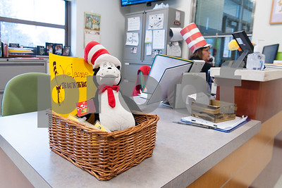 03/02/18  Wesley Bunnell | Staff  A welcome basket for guest readers sits in the main office of Gaffney Elementary School on Friday for Dr. Seuss Day aka Read Across America Day as Joyce Anderson answers the phone.