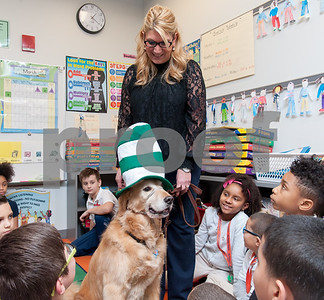 03/02/18  Wesley Bunnell | Staff  Gaffney Elementary School Principal Anita Fazio stands with her dog Cooper who is trained as a therapy dog as she visits Ms. Libby's third grade class on Friday for Dr. Seuss Day aka Read Across America Day.