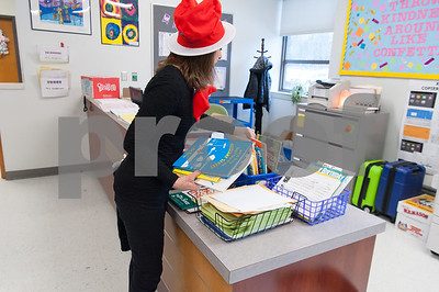 03/02/18  Wesley Bunnell | Staff  Reading teacher Annette Levine picks through the choices of books in the main office of Gaffney Elementary School on Friday for Dr. Seuss Day aka Read Across America Day.