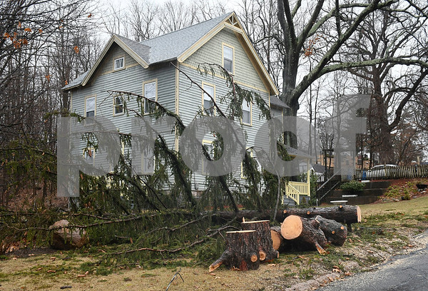 3/2/2018 Mike Orazzi | Staff A tree that fell near the entrance to the West Cemetery in Bristol during Friday's storm.