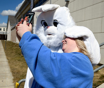 3/24/2018 Mike Orazzi | Staff Candy Tobin poses with the Eastern Bunny while at the annual Terryville Lions Club Easter Egg Hunt held at Terryville High School Saturday.
