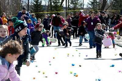 3/24/2018 Mike Orazzi | Staff Children scramble while searching for eggs while at the annual Terryville Lions Club Easter Egg Hunt held at Terryville High School Saturday.