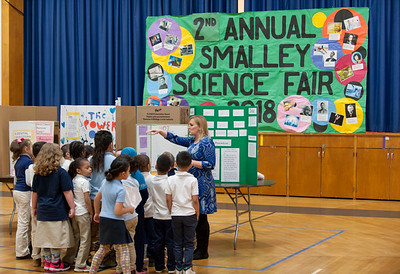 03/27/18  Wesley Bunnell | Staff  First grade teacher Mrs. Poff leads her class through the 2nd Annual Smalley Science Fair on Tuesday morning featuring science exhibits by all grades.