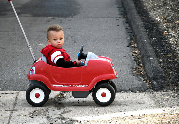 3/28/2018 Mike Orazzi   Staff Tyshawn George Teague,1, while out with his mother Elizabeth Melendez on Jacobs Street in Bristol Wednesday.