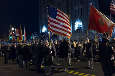 03/30/18  Wesley Bunnell | Staff  Sacred Heart Church held a Stations of the Cross on Friday night featuring a procession up Broad St looping back around to finish at the church. Members of Haller Post 111 prepare to lead the procession.