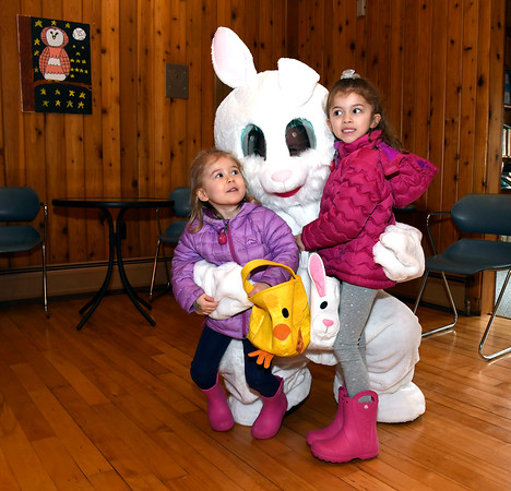 3/30/2018 Mike Orazzi | Staff Sisters Zoe Friar ,3 and Hayley,6, while meeting with the Easter bunny during the Barnes Memorial Nature Center's candy-free Egg Hunt Friday in Bristol.