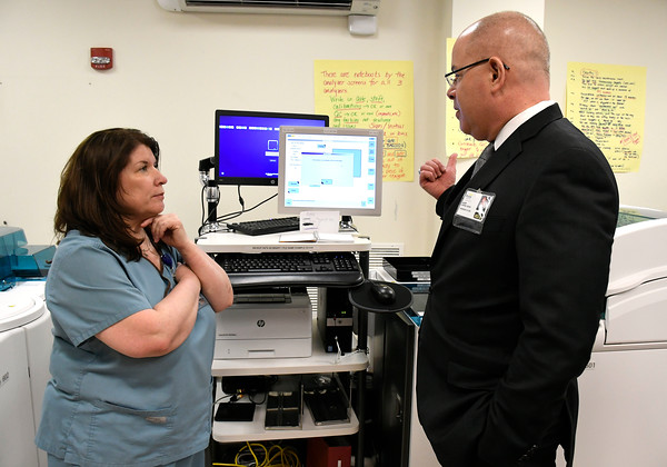 3/29/2018 Mike Orazzi | Staff Bristol Hospital president Kurt Barwin talks with Kelly Bombard about the newly installed battery of new laboratory equipment which will result in enhanced capabilities and quicker turnaround times for patients undergoing lab tests.