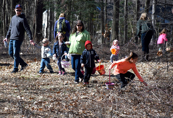 3/31/2018 Mike Orazzi | Staff Children look for Easter eggs during the Easter Eggstravanganza at the Hungerford Park Nature Center in Kensington Saturday.