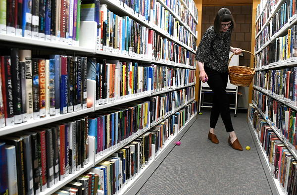 3/31/2018 Mike Orazzi | Staff Kaitlin Checovetes while hiding eggs before the start of the Manross Library Easter Egg hunt on Saturday in Bristol.