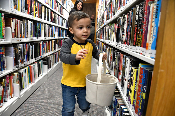 3/31/2018 Mike Orazzi | Staff Jace Jaramillo hunts for plastic eggs at the Manross Library Easter Egg hunt on Saturday in Bristol.