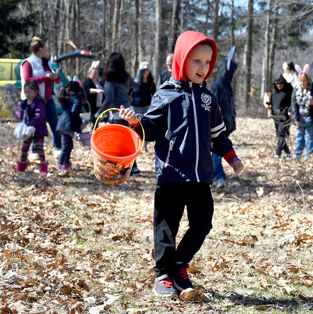 3/31/2018 Mike Orazzi | Staff Gavin Calvert looks for Easter eggs during the Easter Eggstravanganza at the Hungerford Park Nature Center in Kensington Saturday.