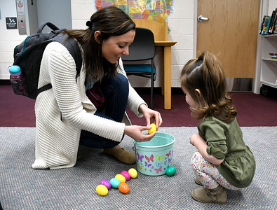 3/31/2018 Mike Orazzi | Staff Kristen Beaudoin and her daughter Peyton open plastic eggs at the Manross Library Easter Egg hunt on Saturday in Bristol.