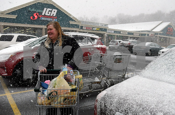 3/7/2018 Mike Orazzi | Staff Debra Serencko while picking up some items at the IGA Supermarket in Terryville at the start of Wednesday's storm.