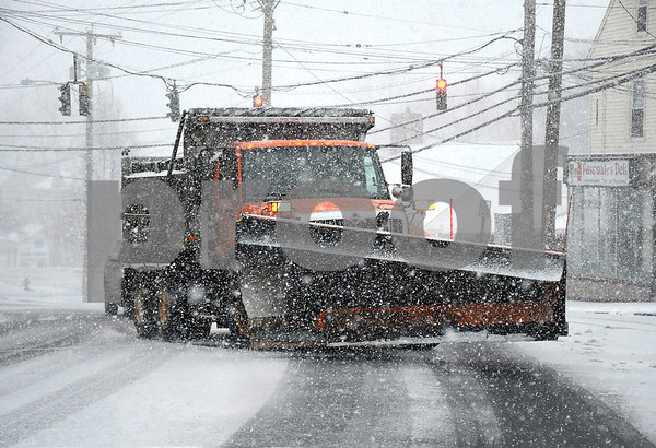 3/7/2018 Mike Orazzi | Staff A Town of Plymouth snowplow crosses Route 6 at North Main Street during Wednesday's storm.