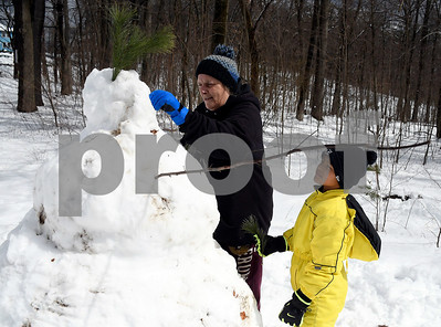 3/8/2018 Mike Orazzi   Staff Melissa Matthews and her son Myles, turning 9 this Saturday, while working on a snowman in Bristol's Rockwell Park Thursday morning.
