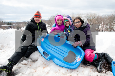 03/08/18  Wesley Bunnell   Staff  Taking a break from sledding are Mohammed Essaqui, age 13, Nora Boumargoud, age 7, Fatima Essaqui, age 9, and Aya Amekzaz, age 10.  The group was sledding at Smith Elementary School on Thursday following heavy snow through the city on Wednesday afternoon through the night.