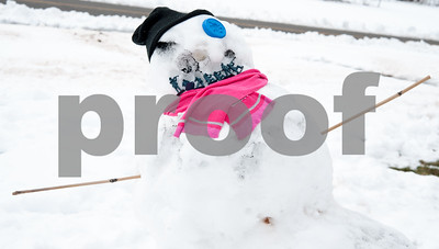 03/08/18  Wesley Bunnell   Staff  A snowman featuring army men was made by children on Ellis St after a winter storm dumped heavy snow on New Britain Wednesday night.