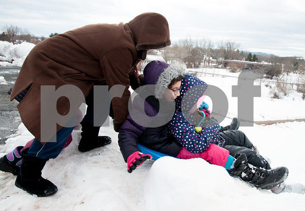 03/08/18 Wesley Bunnell | Staff Saadia Enniour pushes Aya Amekzaz, age 10 middle, and Fatima Essaqui, age 9 down the hell on their sled next to Smith Elementary School on Thursday following heavy snow through the city on Wednesday afternoon through the night.