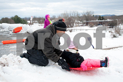 03/08/18  Wesley Bunnell   Staff  Dayna Eatmon prepares to give push down the hill sledding to daughter Daynalis, age 3, at Smith Elementary School on Thursday following heavy snow through the city on Wednesday afternoon through the night.