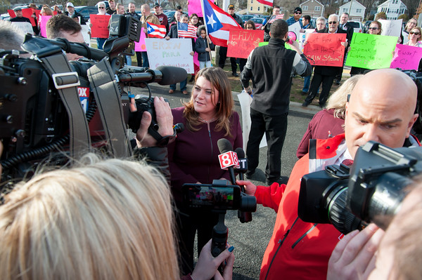 04/04/18 Wesley Bunnell | Staff New Britain Mayor Erin Stewart is interviewed outside of New Britain High School before the CT GOP held their 4th gubernatorial debate of the season as supporters hold signs and chant in her support. Mayor Stewart was unable to speak at the event for not reaching the minimum funds required to participate.