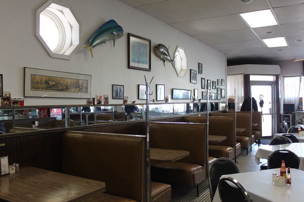 Mayflower Cafe, an old fashioned diner with booths and a mounted fish on the wall