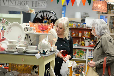 B.J. Parsons,left, and Bobbie Dechant,right, shop Friday inside Little Red Hen Vintage Hen in downtown Chico. (Matt Bates -- Enterprise-Record)
