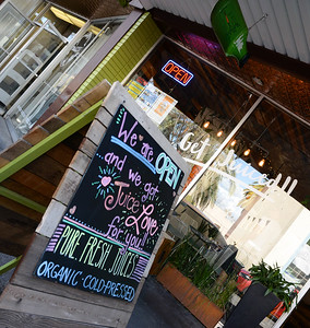 A sandwich board welcomes customers Friday to Live Life Juice Co. in downtown Chico. The store was featured in the California Dream Eater video series. (Matt Bates -- Enterprise-Record)