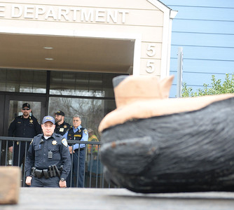 Paradise police officers watch as the Black Bear Diner bear sculp[ture arrives Thursday at the Paradise Police Department. (Matt Bates -- Enterprise-Record)