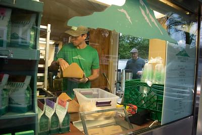 Andrew Kellehar fills orders in the tight confines of the former bank drive thru. (Bill Giduz photo)
