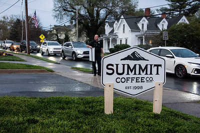 A line of cars stretched from the old bank drive thru all the way to Main and Concord, and even along Concord Road as folks anxiously awaited the combination of Kindred Milk Bread Doughnuts and Summit Coffee. (Bill Giduz photo)