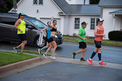 Cathryn Westra waves as she runs by with a group of local runners. No doughnuts for this group. (Bill Giduz photo)